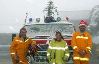 Mt Buller CFA captain Andrew Kelly, Carly Reudavey and Luke Corbett in the snow at Mt Buller on Christmas morning.